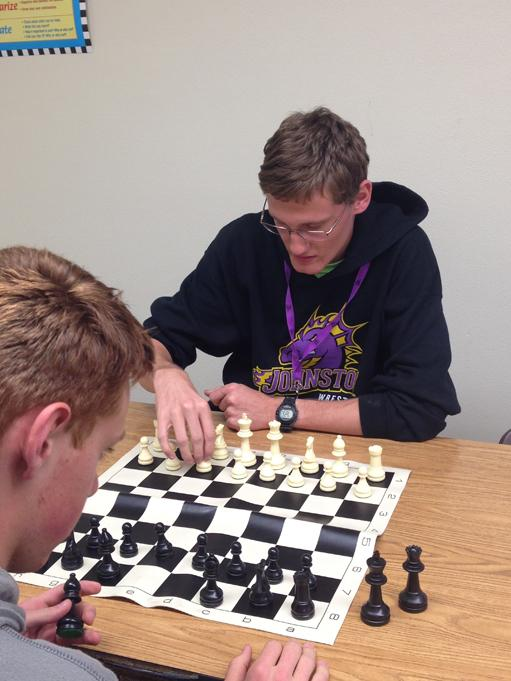 Junior+Austin+Russ+plays+against+junior+Edward+Hovhannisyan+at+the+second+chess+club+meeting.+The+club+meets+every+Tuesday+in+teacher+Jesse+Dowell%27s+room+until+3%3A45+p.m.+
