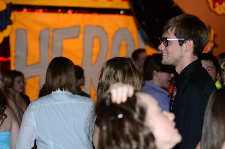 Senior JT Mull smiles as his group dances. The dance was held Sept. 27 at Summit.
