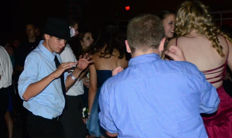 Sophomore David Hindman busts a move surrounded by his friends. The dance was held Sept. 27 at Summit.