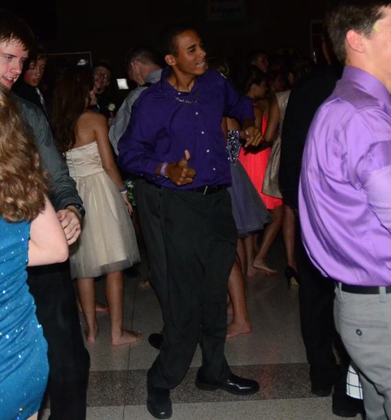 Junior Zach Baer-Deffebaugh shows off his moves. The dance was held Sept. 27 at Summit.