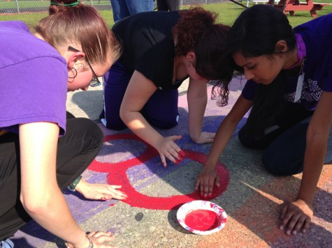 Juniors (from left to right) Analea Couture, Alisha Giesselmann and Michelle Kumar help repaint the GSA's stadium painting.