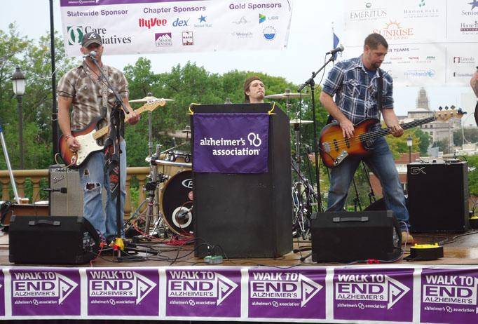 Local up-and-coming country band Rebyl Road performs before the walk. Some of the band members had family members with Alzheimer's.