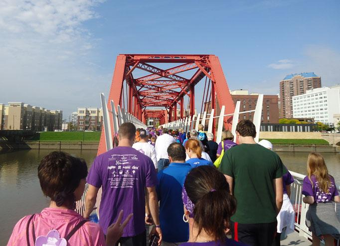 The supporters go over the Principal River Walk. This was the first time the bridge had been used for the Alzheimer's walk.