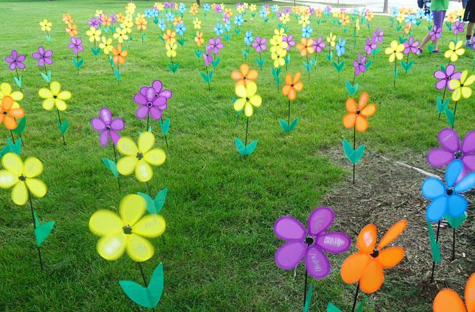 The makeshift Promise Garden features four different colors. People were asked to take their flowers with them on the walk, as there were too many people for a full-sized garden