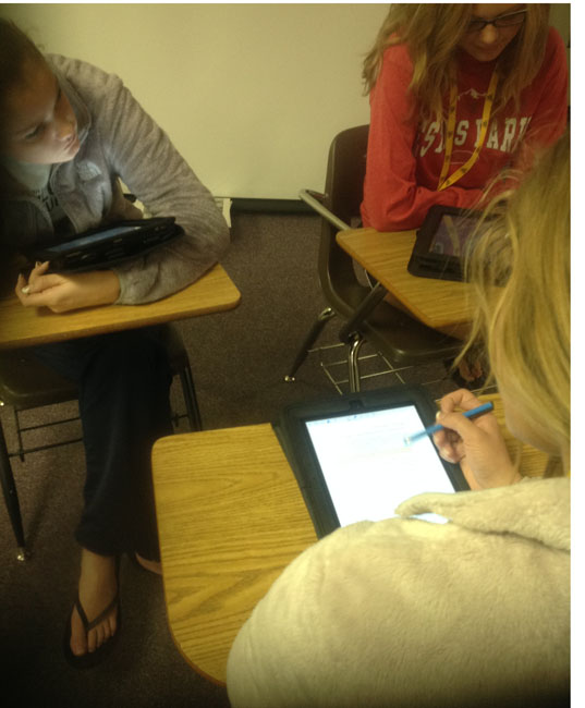 Students work on their assignments for class over the iPads.