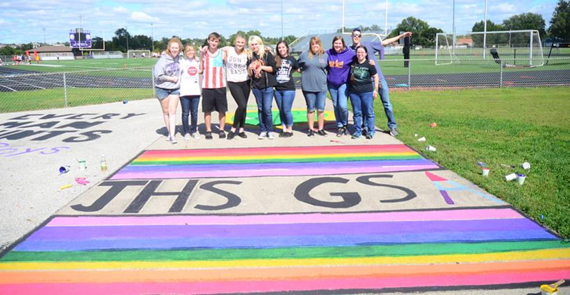 The+GSA+%28Gay-Straight+Alliance%29+club+poses+by+their+stadium+painting.+The+group+has+been+celebrating+since+the+Supreme+Court+ruling+went+into+effect.