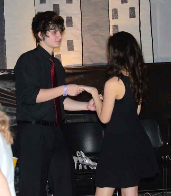 Senior+Justin+Adkins+and+his+date+junior+Heather+Krejci+dance+off+from+the+crowd.+The+homecoming+dance+was+held+on+Sept.+27+at+Summit+Middle+School.
