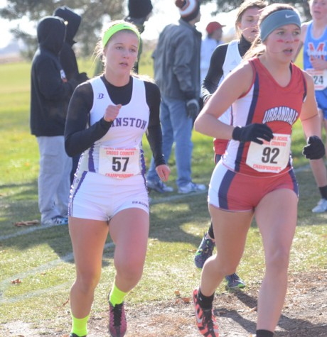 Junior Maddy Bradley begins to pass an Urbandale runner during the state meet. Urbandale finished second behind Johnston by 18 points.