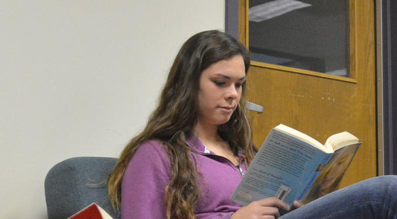 Junior Megan Kimrey was captured reading her book in the library.