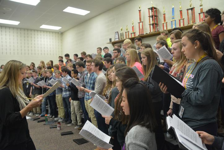 In third hour Nov. 12, choir students warm up their voices in class. Students put in many hours of practice outside of class as well.