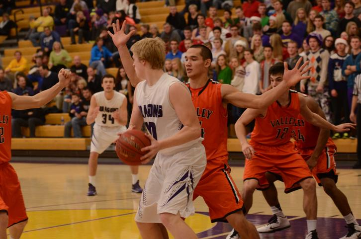 Number 44 from the West Des Moines Valley Tigers boys basketball team guards senior Regen Siems.