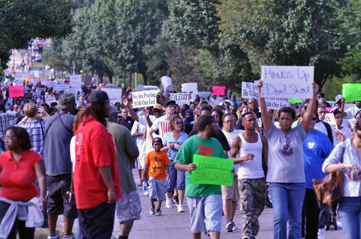 Citizens of Ferguson, MO march down West Florissant Ave. in protest of the death of Michael Brown.