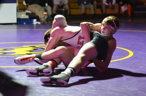 Senior Shane Vaughn takes down Valley wrestler Todd Robinson at 138 pounds during the home meet Jan. 22. Vaughn went on to pin Robinson, helping the Dragons to take the lead. However, the Tigers preceded to take the meet, winning 34-31.