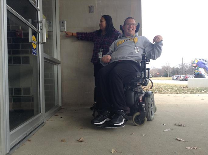 The wheelchair accessible button outside of the front doors can only work when the buzzer is pressed and the front office is notified. Some students, however, cannot reach the buzzer, needing assistance to enter the school when they did not need help prior to this change.