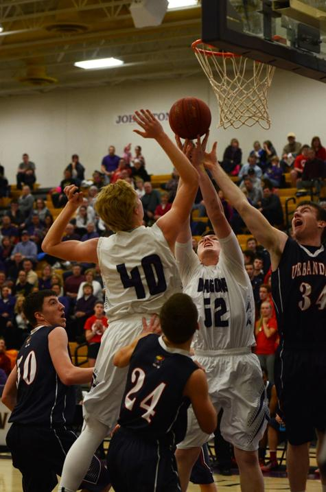 Seniors Regen Siems and Reid Sinnet jump in hopes of getting a rebound.  The boys lost 53-63 to Urbandale.