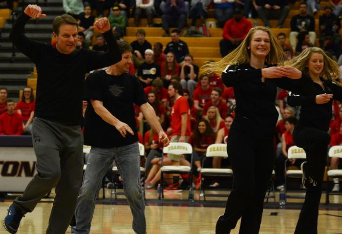 Senior Elizabeth Reiher and her father dance for the annual father daughter dance that the dance team does every year during half time.
