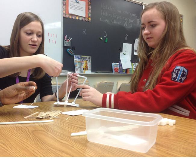 Junior+Olivia+Hrubetz+and+sophomore+Brooke+Thacker+build+a+tower+consisting+of+marshmallows%2C+bendy+straws%2C+and+other+items+in+their+ELP+class.+The+group+activity+was+designed+to+make+students+think+creatively+on+how+to+build+towers+that+can+collapse+on+command+without+being+touched.