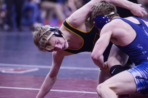 Senior Henry Pohlmeyer wrestles his quarterfinal opponent, Spencer Nevills from Pleasant Valley. Pohlmeyer lost this match 3-0, as well as his consolation match, eliminating him from the tournament.