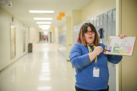 Senior Eilise Murray looks at the schedule to make sure she collects recycling from the correct rooms. Every Wednesday students within the special education department collected recycling from each room in the high school.