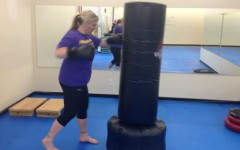Teacher Jennifer Palmer works out at a Farrell's Extreme Bodyshaping kickboxing class. Palmer, along with other teachers, are in the middle of their third week of the fitness challenge.