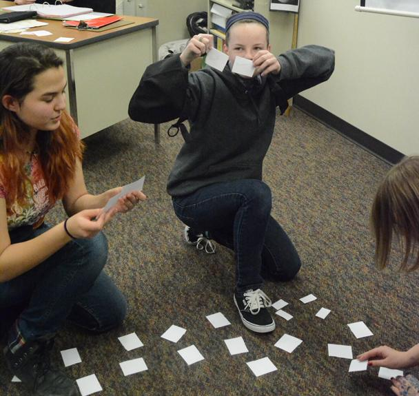 Eighth grader Jaedyn Brockway and sophomore Cassidy Gabbert play a game at the high school GSA meeting. The two clubs came together in a collaborative meeting and a memory game.
