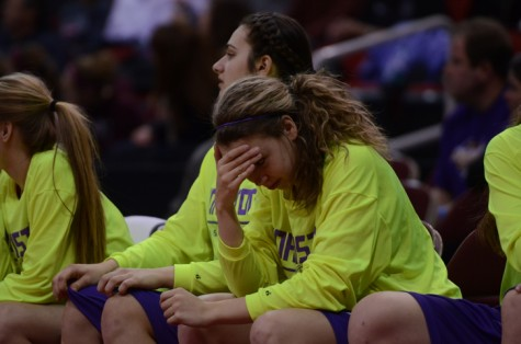 Sophomore Madelyn Hurn holds her head in disappointment as Dowling takes the lead and advances to the semifinals. The girls played Dowling Catholic and lost 58-52, eliminating them from the tournament.