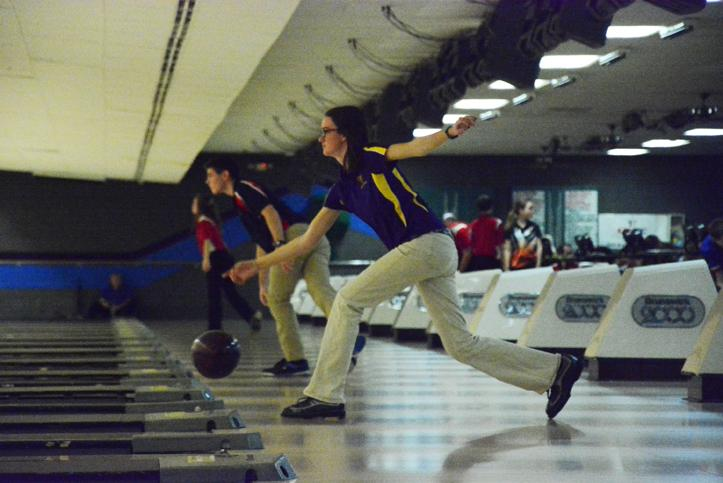 Junior Loyal Ulm throws the ball down the lane in hopes of a strike. In addition to the team finishing with a win at state, Ulm also won the title of individual state champion.
