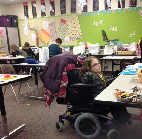 While students in Clothing Seminar wait for the quilting process to be finished by bookkeeper Sharon Von Hagen, they began creating backpacks. The class worked on the patches of a quilt to be auctioned March 7.