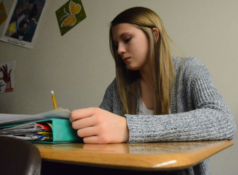 Sophomore Tallie Kerr works on an assignment in Integrated Language Arts (ILA) while watching a video about Nazi Germany in class. Kerr is a dedicated to her studies and is known by friends and family as being hard-working, funny and outgoing.