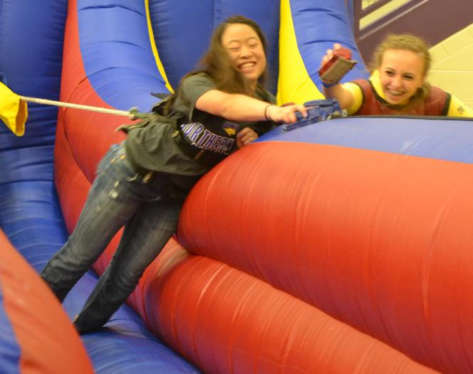 At last year's after prom, seniors Sarah Eikenberry and Katie Cunningham compete to place their markers farthest down the inflatable.
