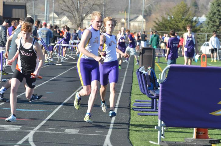 Senior+Matt+Turner+takes+off+after+sophomore+Zane+Johnson+during+the+junior+varsity+four+by+800+meter+relay%2C+placing+first+with+a+total+time+of+8%3A33.52.+The+boys+home+track+meet+was+held+March+31.