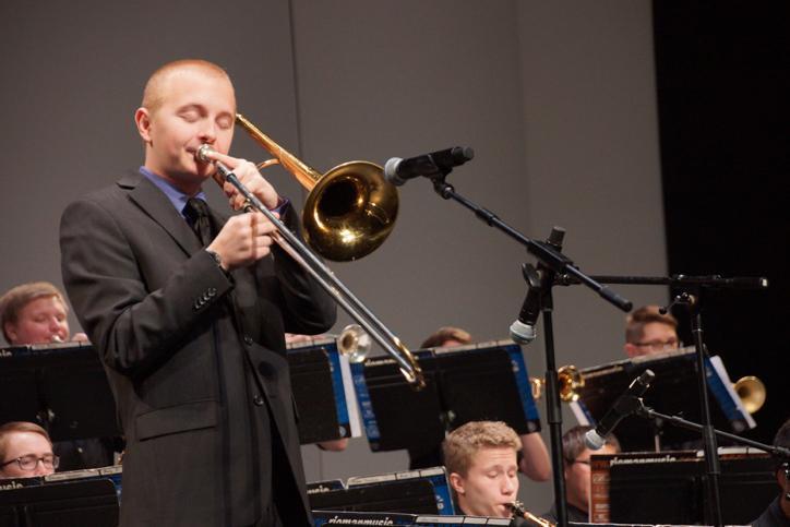 Junior Adam Dostalik performs his trombone solo during the song
