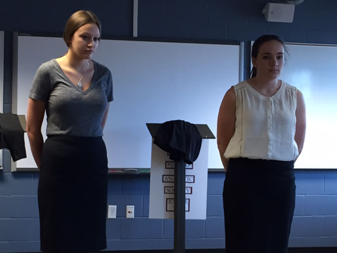 Juniors Olivia Hrubetz and Hannah Hoffman present their projects to a panel of judges at History Day's districts competition April 11.  The duo advanced to state with their performance.