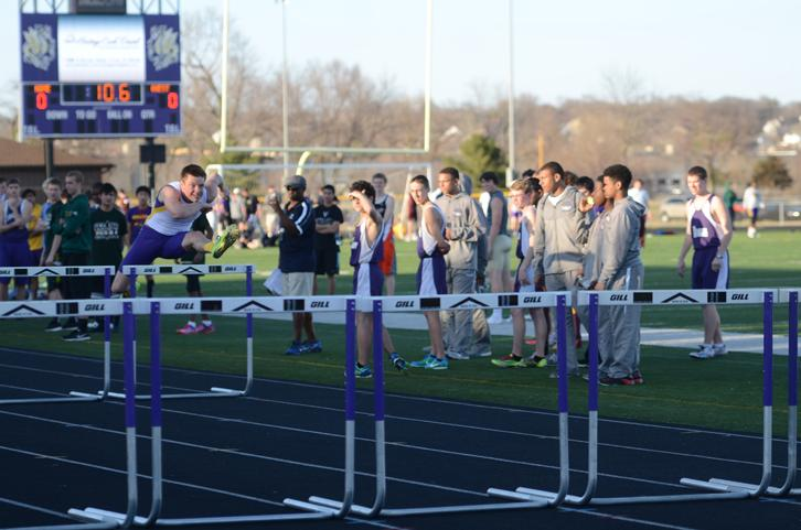 Senior Jack Bergstrom runs the hurdles during the track invitational March 31 at the home football stadium.