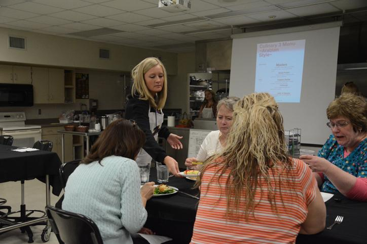 Senior Taylor Anthony serves staff members' their lunches April 9.