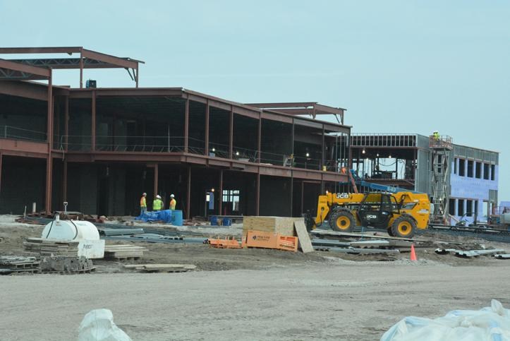 The development of the classroom wings on the east side of the new building.