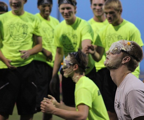 Senior Johnny Holdsworth prepares for the launching of cheese balls towards his face during the challenge pudding face. Rock Around the Clock took place Sept. 28 starting at 6:45 p.m.