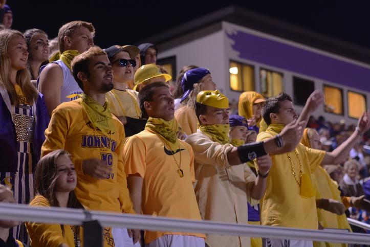 Seniors Sam Linder, Jake Page, and Joe Thatcher cheer while in the senior student section. During the varsity football against Waukee Sept. 18 the student section all wore gold to support.