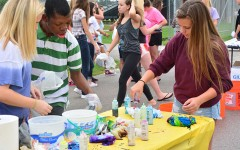 Junior Lauren Bellis helps her new best buddy Meshak Ntambwe along side of junior Breyenne Beierle. The next event held by Best Buddies is the RATC tailgate which will take place before RATC at 5:45 p.m. Sept. 28.
