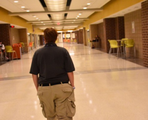 Erin Kohlsdorf, the new school security officer, patrols the hallways of the school. She looks forward to forming relationships with the students and staff through her job.