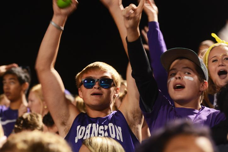 During half-time senior Cade Wagner raises his arms up in excitement with senior Hunter Rose at his side. The varsity football team played against the Urbandale Jayhawks Sept. 11 at home.