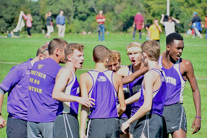 The+varsity+runners+get+pumped+minutes+before+they+start+their+race.+Sept.+19+the+boys%27+varsity+runners+placed+sixth+overall%2C+and+JV+ninth+out+of+26+teams+from+the+heartland+area.
