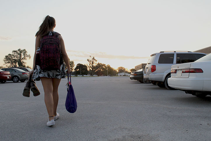 Junior Avery Gathercole walks back to her car in the high school's new gravel parking lot.