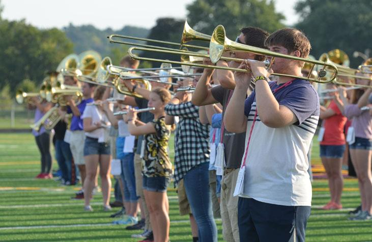 Sophomore Andrew Spaulding plays his trombone in the morning during marching band. Marching band rehearses every morning starting at 7:00 a.m. all the way through first period on the football field.
