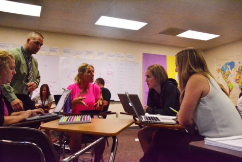 P.E. teacher Deb Nicholson talks to a small group of teachers about how they can better students' education as part of the TLC program. The meeting took place in Government teacher Tom Griffin's room Sept. 16.