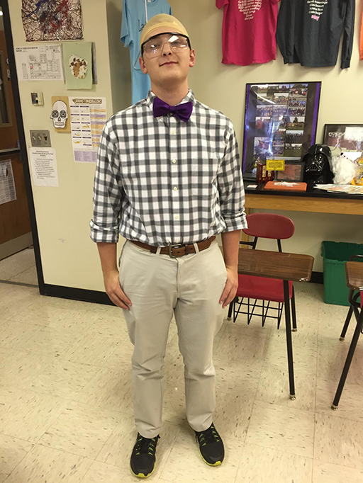 Senior Austin Jesperson dresses up as chemistry teacher Dave Oldham with a bow tie and bald cap.