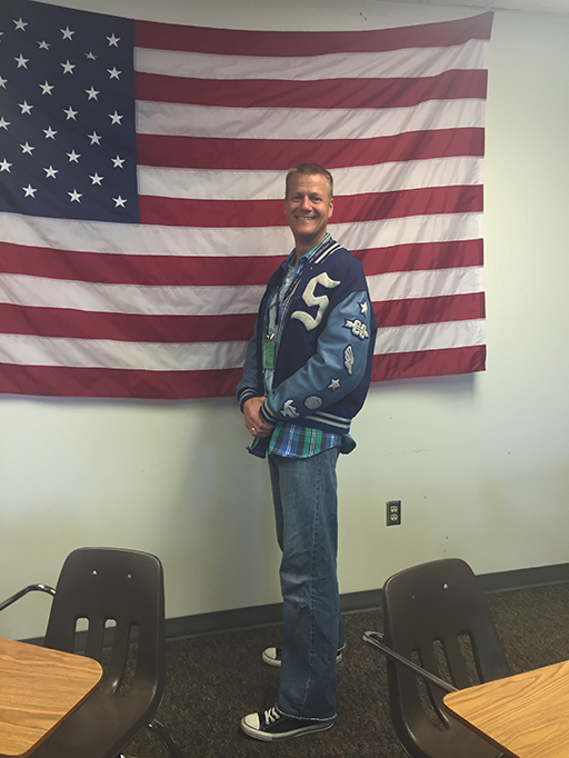 Government teacher Patrick Hennes sports a letterman jacket for Throw Back Thursday.