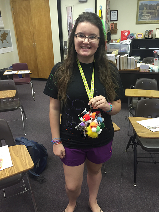 With a bundle of Weebles from the Summit Middle School days is senior Clarissa Short.