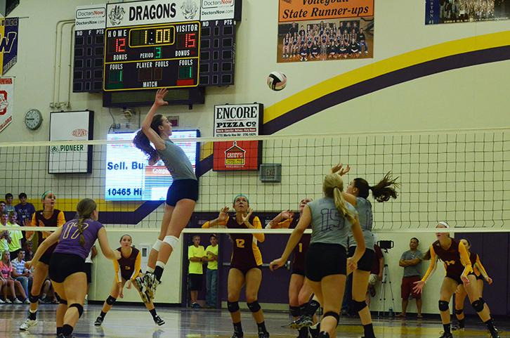 Junior+Taryn+Knuth+retracts+for+the+spike+set+up+by+junior+Anna+Miller.+The+Varsity+volleyball+team+played+against+the+Ankeny+Hawks+Tuesday+Sept.+2.