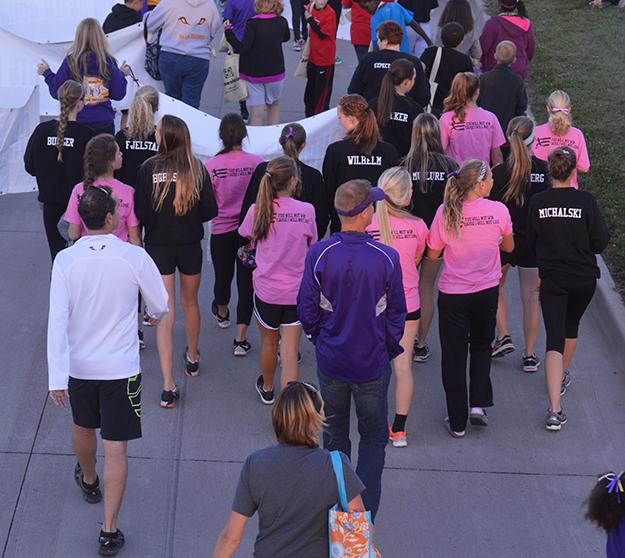 Cross country coaches Patrick Hennes and Chris Siewert walk among the cross country girls' in the parade. The homecoming parade started across from Panera and ended at the high school Oct. 1 starting at 6 p.m.